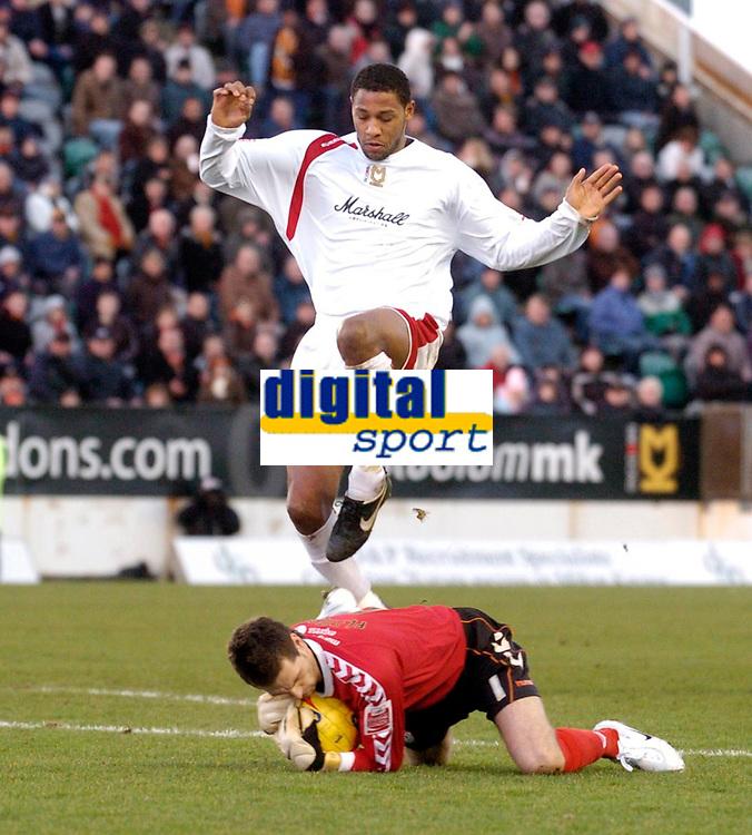 Photo: Leigh Quinnell.<br /> Milton Keynes Dons v Barnet. Coca Cola League 2. 20/01/2007. MK Dons Clive Platt jumps to avoid Barnet goalkeeper Ross Flitney.