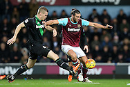Andy Carroll of West Ham United blocks the ball from Ryan Shawcross, the Stoke City captain. Barclays Premier league match, West Ham Utd v Stoke city at the Boleyn Ground, Upton Park  in London on Saturday 12th December 2015.<br /> pic by John Patrick Fletcher, Andrew Orchard sports photography.