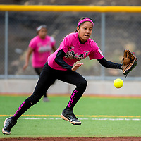 071513       Brian Leddy<br /> Ft. Defiance player Shyenne Yazzie chases down a ball during a  Big League softball tournament game against Gallup Monday.