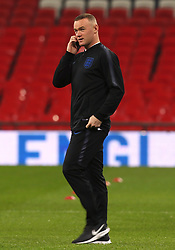 England's Wayne Rooney answers a phone call
