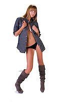 Young and sensual woman with man shirt and boots.