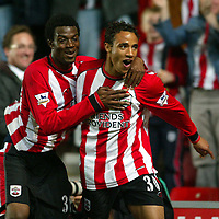 Photo: Scott Heavey, Digitalsport<br /> NORWAY ONLY<br /> <br /> Southampton v Newcastle united. FA Barclaycard Premiership. 12/05/2004.<br /> Leandre Griffin celebrates scoring Southampton's third with Yoann Folly (L)