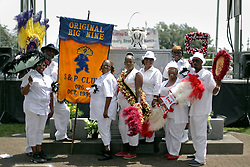 29 August 2015. Lower 9th Ward, New Orleans, Louisiana.<br /> Hurricane Katrina 10th Anniversary.<br /> Members of the Original Big Nine Social Aid and Pleasure Club at the monument dedicated to the victims and survivors of those lost to the storm. <br /> Photo credit©; Charlie Varley/varleypix.com.