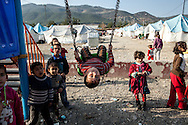 Syrian children play in a park at the centre of Islahiye refugee camp for those fleeing the violence at home. 02/01/2013