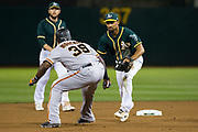 San Francisco Giants right fielder Carlos Moncrief (39) gets caught in a pickle by the Oakland Athletics at Oakland Coliseum in Oakland, California, on July 31, 2017. (Stan Olszewski/Special to S.F. Examiner)