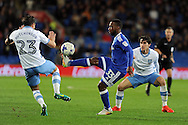 Cardiff City's Junior Hoilett (c) controls the ball while being challenged by Sheffield Wednesdays Sam Hutchinson (23) and Kieran Lee (r). EFL Skybet championship match, Cardiff city v Sheffield Wednesday at the Cardiff city stadium in Cardiff, South Wales on Wednesday 19th October 2016.<br /> pic by Carl Robertson, Andrew Orchard sports photography.