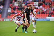 Portsmouth FC defender Matthew Clarke (5) and Doncaster Rovers midfileder Matty Blair (17)  during the EFL Sky Bet League 1 match between Doncaster Rovers and Portsmouth at the Keepmoat Stadium, Doncaster, England on 25 August 2018.Photo by Ian Lyall.
