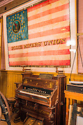Organ and flag in the Miner's Union Hall, Bodie State Historic Park, California USA