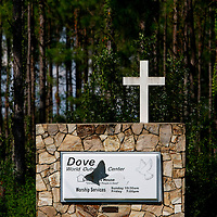 GAINESVILLE, FL -- Sept. 10, 2010 -- Vandalism cover the sign outside where Florida pastor Terry Jones, whose plans are on hold to burn the Koran on Sept. 11th, speaks during a press conference outside of the Dove World Outreach Center in Gainesville, Fla., on Friday, September 10, 2010.  (Chip Litherland for The New York Times)