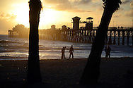 Silhouette of trees and men walking on beach near Oceanside Pier at sunset. Oceanside, CA. USA<br /> <br /> THIS IMAGE ALSO AVAILABLE AS SIGNED, LIMITED EDITION PRINT. SERIES LIMITED TO 10.<br /> <br /> EMAIL RR@ROBERTRANDALL.COM FOR PRICING