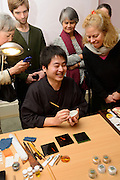 "Maki-e Baisen craftsman Muneaki Shimode gives a demonstration. Kintsugi event, Daiwa Anglo-Japanese Foundation, London, UK, January 24, 2014. Kintsugi literally means ""joining with gold"": a technique to piece together broken pottery or glass with lacquer, rice-glue and gold."