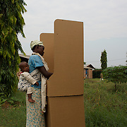 A voter marks her vote at a polling station in Kinama neighbourhood in Bujumbura, to vote in the country's parliamentary elections, on June 29, 2015.