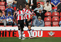Photo: Lee Earle.<br /> Southampton v Cardiff City. Coca Cola Championship. 21/10/2007. Stern John (L) is congratulated by Inigo Idiakez after scoring Southampton's first.