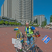 An environmental protester prepares to ride his bike as parch of a march through downtown San Francisco.