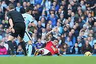 Marcos Rojo of Manchester United goes into a tackle which leads to him being stretchered off injured - Barclays Premier League - Manchester City vs Manchester Utd - Etihad Stadium - Manchester - England - 2nd November 2014  - Picture David Klein/Sportimage