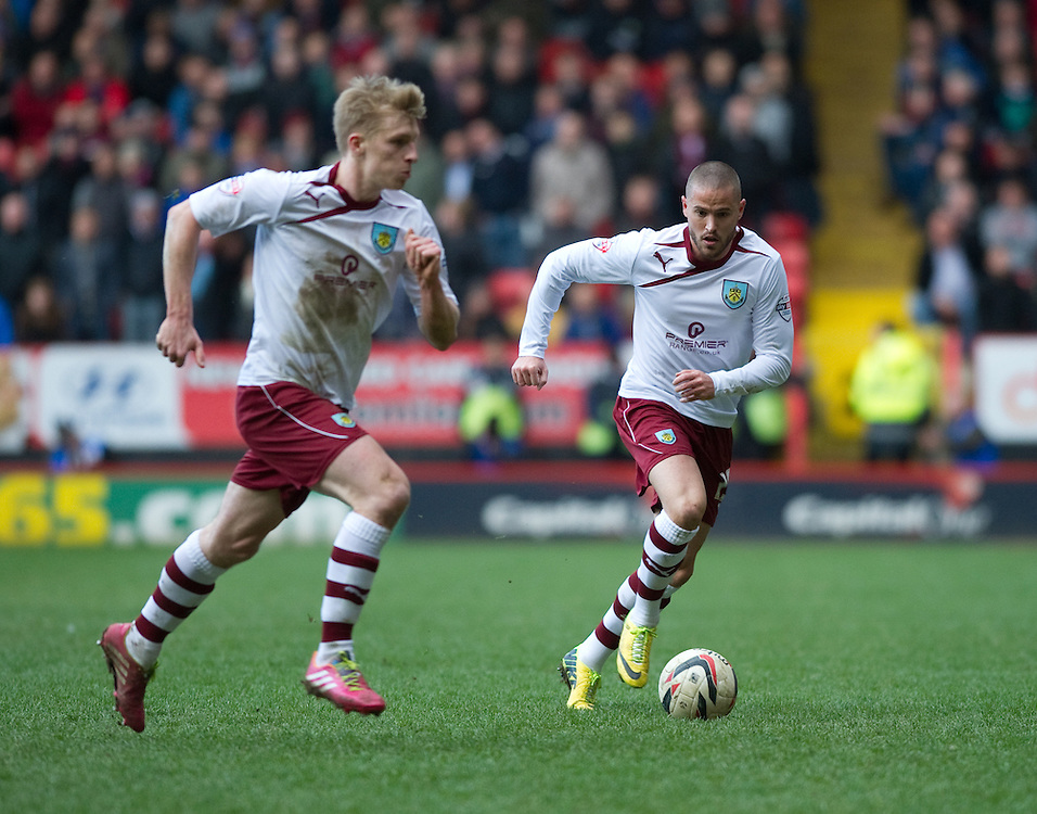 Burnley's Michael Kightly in action during todays match  against Charlton Athletic<br /> <br /> Photo by Ashley Western/CameraSport<br /> <br /> Football - The Football League Sky Bet Championship - Charlton Athletic v Burnley - Saturday 22nd March 2014 - The Valley - London<br /> <br /> © CameraSport - 43 Linden Ave. Countesthorpe. Leicester. England. LE8 5PG - Tel: +44 (0) 116 277 4147 - admin@camerasport.com - www.camerasport.com