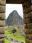View of Huayna Picchu through a doorway, at the Incan ruins of Machu Picchu, near Aguas Calientes, Peru.