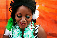 A woman waits for her ride after a St. Patrick's Day Festival.