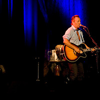 Bruce Springsteen sings his songs to an audience gathered at the Paramount Theater in Asbury Park for a concert to benefit the American Red Cross.
