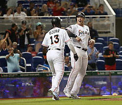 June 19, 2017 - Miami, FL, USA - Miami Marlins' Justin Bour is congratulated by teammate Marcell Ozuna after his third inning grand slam home run against the Washington Nationals on Monday, June 19, 2017 in Miami, Fla. (Credit Image: © Patrick Farrell/TNS via ZUMA Wire)