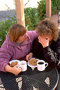 Friends age 55 and 50 discussing recent family tragedy.  St Paul  Minnesota USA