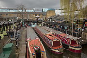 Three narrowboats at Camden Lock in Camden Town on the 27th March 2018 in North London, United Kingdom.