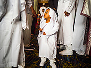 04 JUNE 2019 - DES MOINES, IOWA: A child in the crowd after Eid al Fitr services in the Iowa Events Center in Des Moines Tuesday. About 3,000 people were expected to attend the annual community wide celebration of Eid al Fitr which marks the end of Ramadan, the Muslim month of fasting. According to the event organizers, there are about 15,000 Muslims in the Des Moines area.           PHOTO BY JACK KURTZ