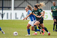 Jamie-Lee Napier of Birmingham City Women battles for possession with Cho So-hyun of Tottenham Hotspur Women during the FA Women's Super League match between BIrmingham City Women and Tottenham Hotspur Women at Solihull Moors FC, Solihull, United Kingdom on 9 May 2021.