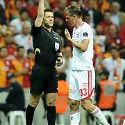 Referee's Firat Aydınus show the yellow card to Sivasspor's Jan Rajnoch (R) during their Turkish Super League soccer match Galatasaray between Sivasspor at the AliSamiYen Spor Kompleksi TT Arena at Seyrantepe in Istanbul Turkey on Sunday 05 May 2013. Photo by TURKPIX