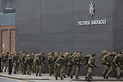 Soldiers return from training with backpacks to Victoria Barracks on 7th October 2021 in Windsor, United Kingdom. Victoria Barracks is home to the 1st Battalion Coldstream Guards, the oldest continually serving regiment in the British Army, which also has a ceremonial role in protecting Windsor Castle.
