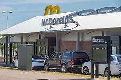 © Licensed to London News Pictures; 02/06/2020; Weston-super-Mare, UK. Vehicles queue at the McDonalds Drivethru at the Queensway Centre in Worle, on its first day of reopening after lockdown during the coronavirus covid-19 pandemic, after the fast food chain announced they were reopening 168 branches across the UK for drive-thru and a further 22 for McDelivery service. Photo credit: Simon Chapman/LNP.
