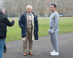 Emmy award-winning actor Jon Hamm as Archangel Gabriel filming a scene from Neil Gaiman &  Terry Pratchett's adaptation of Good Omens in Battersea Park, London, Great Britain <br /> 4th December 2017 <br /> <br /> Jon Hamm is best known for playing advertising executive Don Draper in the TV drama series, Mad Men<br /> <br /> <br /> Seen here in a scene jogging with Michael Sheen who plays the character Aziraphale<br /> <br /> Photograph by Elliott Franks <br /> <br /> Photograph by Elliott Franks <br /> Image licensed to Elliott Franks Photography Services