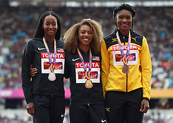 USA's Kori Carter (centre, gold) USA's Lalillah Muhammad (left silver) and Jamaca's Ristananna Tracey during the medal ceremony for the women's 400m hurdles during day eight of the 2017 IAAF World Championships at the London Stadium.