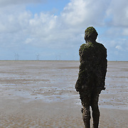 Another Place is a piece of modern sculpture by Sir Antony Gormley. It consists of 100 cast iron sculptures of the artist's own body, facing towards the sea.<br /> <br /> After being displayed at several locations in Europe, it has become permanently located at Crosby Beach in northwestern England. The work was controversial in the local area due to issues such as possible economic gain or environmental damage from tourism. A meeting on 7 March 2007 by Sefton Council accepted proposals that would allow the sculptures to be kept permanently at Crosby Beach in place of being moved to New York.