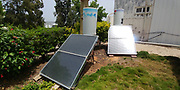 Close up Solar water heater collectors on lawn. Photographed in Israel
