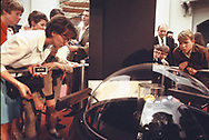 Visitors to the Smithsonian Air and Space Museum view a rock from the Moon in April 1970.<br />Photo by Dennis Brack bb72