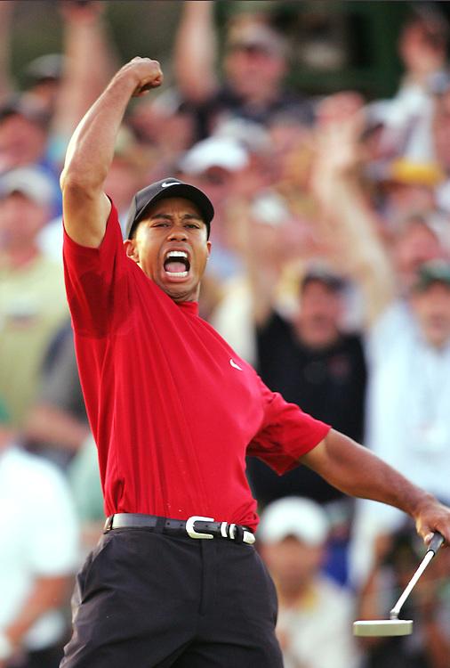 Tiger Woods celebrates winning the 2005 Masters Tournament. Sunday, April 10 2005, Augusta National GC. Augusta, GA.. Photograph by Darren Carroll.