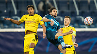SAINT PETERSBURG, RUSSIA - DECEMBER 08: Magomed Ozdoev of Zenit St. Petersburg challenges Jude Bellingham [left] and Marco Reus [right] of Borussia Dortmound for the header during the UEFA Champions League Group F stage match between Zenit St. Petersburg and Borussia Dortmund at Gazprom Arena on December 8, 2020 in Saint Petersburg, Russia. (Photo by MB Media)
