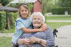 Senior woman on wheelchair with grandson at rest home park, Bavaria, Germany