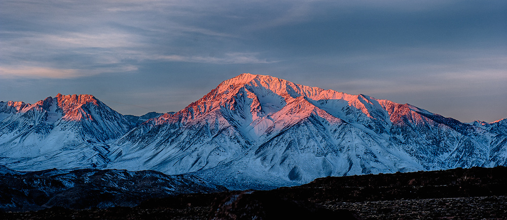 The sun lit up the peaks of the Eastern Sierra Mountains in California..