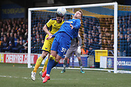 AFC Wimbledon striker Joe Pigott (39) battles for possession with Oxford United defender John Mousinho (30) during the EFL Sky Bet League 1 match between AFC Wimbledon and Oxford United at the Cherry Red Records Stadium, Kingston, England on 10 March 2018. Picture by Matthew Redman.