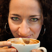 Heather Goodrich drinks a mocha at Vivace in downtown Seattle, Washington.