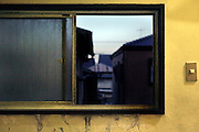 dilapidated window frame and view towards residential housing