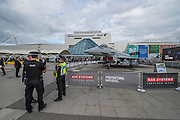 Security is tight and police and a BAE Typhoon Euorfighter stand guard outside the entrance - The DSEI (Defence and Security Equipment International) exhibition at the Excel Centre, Docklands, London UK 15 Sept 2015
