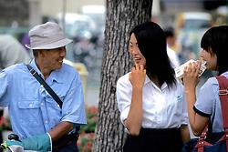 Girls Talking With Older Man