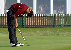 Ernie Els reacts after missing the winning putt on the 18th green during the final day of the 131st Open Championship at Muirfield, Scotland.