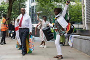 Windrush campaigners, including co-founder of the Windrush Defenders Legal C.I.C. Anthony Brown l, protest outside the Home Office on 23rd June 2021 in London, United Kingdom. The campaigners later marched from the Home Office to the House of Commons to deliver a letter calling for a new independent body, and not the Home Office, to administer the scheme intended by the government to compensate them for the violation of their rights. Many legal residents who came to the UK from the Caribbean lost their homes, jobs and other rights after having been targeted by the Home Office.