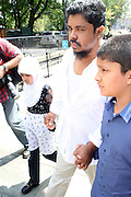 26 August 2010- New York, NY--Ahmed Sharief and his family arrive to Demonstrate on the steps of City Hall and to denounce violent hate crimes against Taxi Drivers in New York City. ..Taxi Cab Driver Ahmed Sharif was slashed and stabbed by a passenger who first asked if he were muslim, and then savagely stabbed him 5 times over  his face, throat and arms by 21year-old Michael Enright, a College Student at School of Visual Arts who had just returned from Afghanistan.