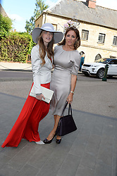 Left to right, KATIE READMAN and NATALIE PINKHAM at the wedding of Lady Natasha Rufus Isaacs to Rupert Finch held at St.John The Baptist Church, Cirencester, Gloucestershire, UK on 8th June 2013.