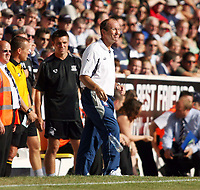 Photo: Chris Ratcliffe.<br />Southend United v Stoke City. Coca Cola Championship.<br />05/08/2006.<br />Tony Pulis, manager of Stoke City throws his water bottle to the ground as Steve Tilson manager of Southend watche son in the background